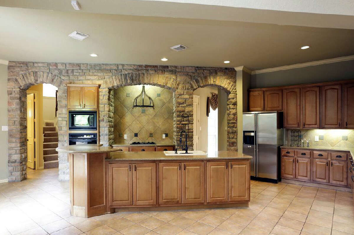 An island kitchen connects to the family room.