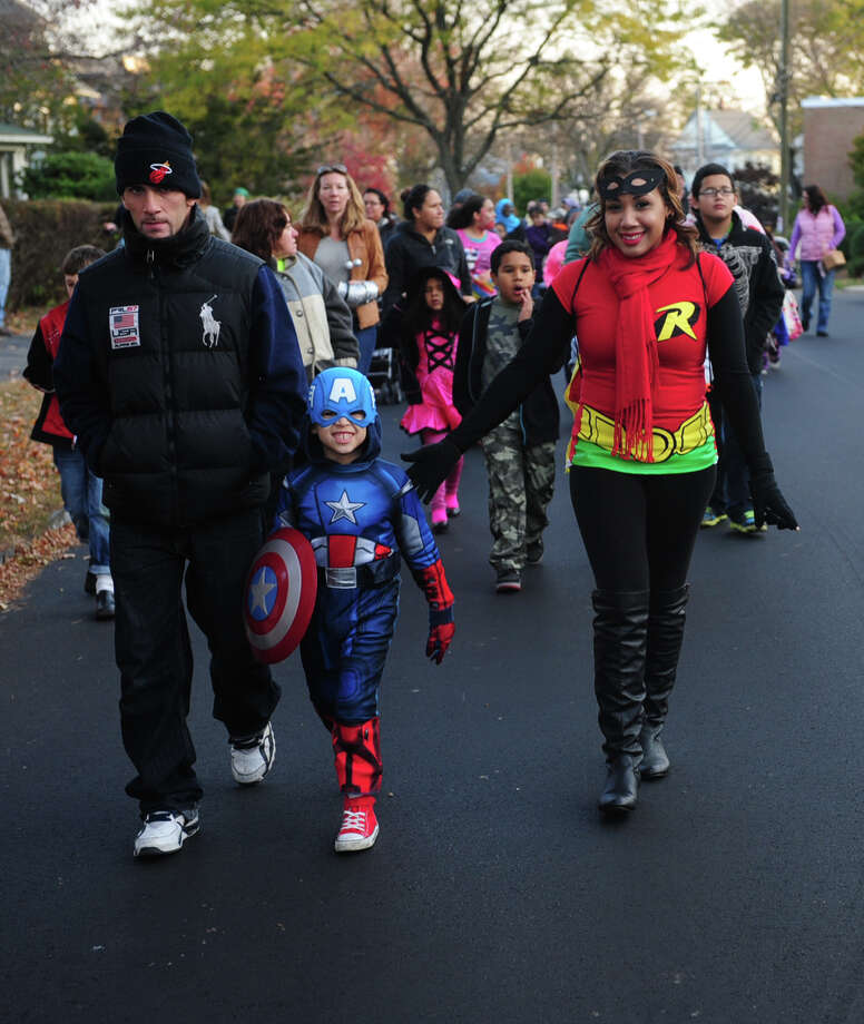 The 5th Annual Black Rock Halloween Parade & Block Party travels from Ellsworth Park to the Black Rock Branch Library Tuesday, Oct. 29, 2013 in Bridgeport, Conn. Photo: Autumn Driscoll / Connecticut Post