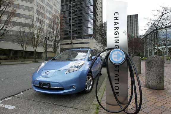 This March 31, 2011 file photo shows an electric charging station in downtown Portland, Ore.  The governors of eight states including California and New York pledged Thursday to get 3.3 million zero-emission vehicles on roadways by 2025 in an effort to curb greenhouse gas pollution.  (AP Photo/Rick Bowmer)