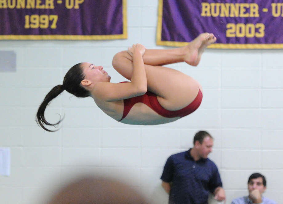 Ines Villemure of Greenwich High School during the FCIAC Girls Diving Championships at Westhill High School in Stamford, Tuesday, Oct. 29, 2013. Photo: Bob Luckey / Greenwich Time