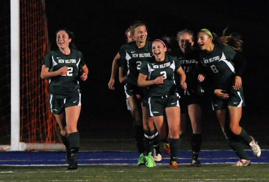 New Milford's Jennifer Millar (3) celebrates her goal with teammates in the SWC girls soccer semifinals game between New Milford and Joel Barlow at Brookfield High School in Brookfield, Conn. on Tuesday, Oct. 29, 2013. Photo: Tyler Sizemore / The News-Times