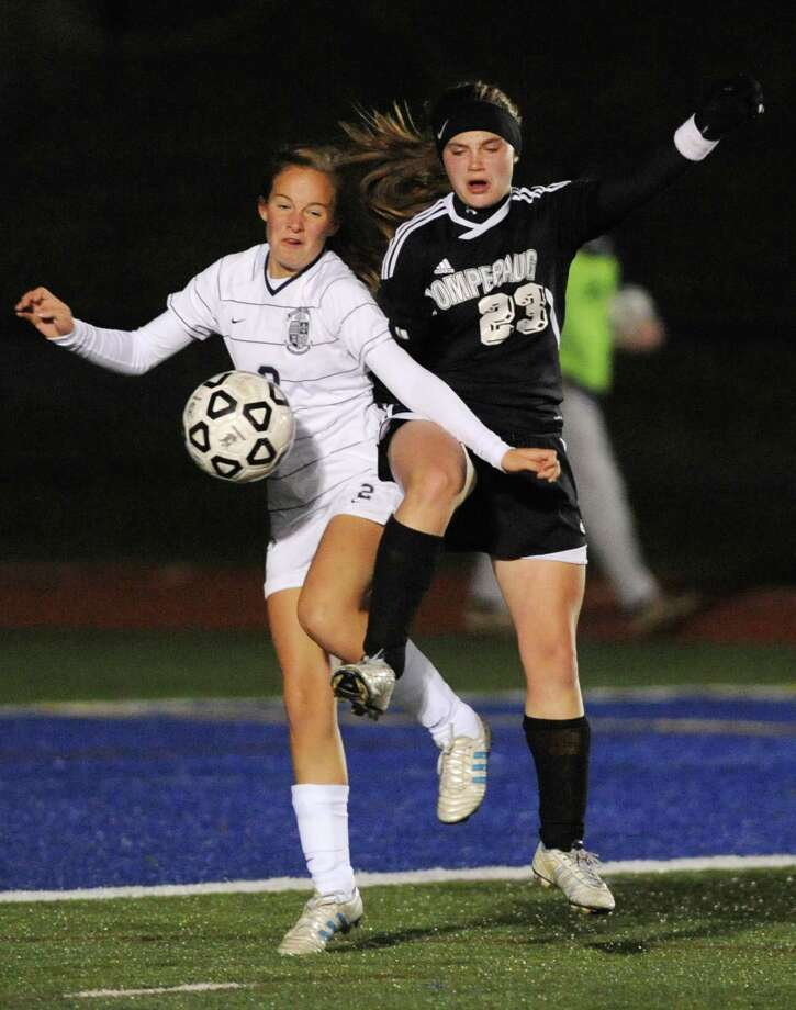 Immaculate's Katie McAdams (2) and Pomperaug's Caly Farina (23) battle for the ball in the SWC girls soccer semifinals game between Immaculate and Pomperaug at Brookfield High School in Brookfield, Conn. on Tuesday, Oct. 29, 2013. Photo: Tyler Sizemore / The News-Times
