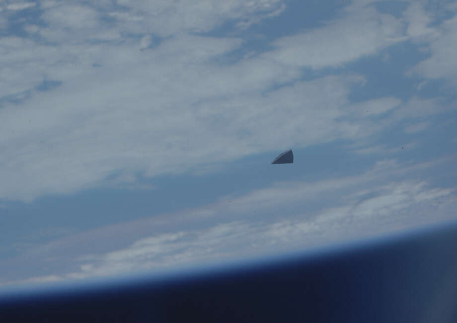 Hi-res snapshot of the mysterious object in space.  (Check out the story for what it is). Photo: Multiple