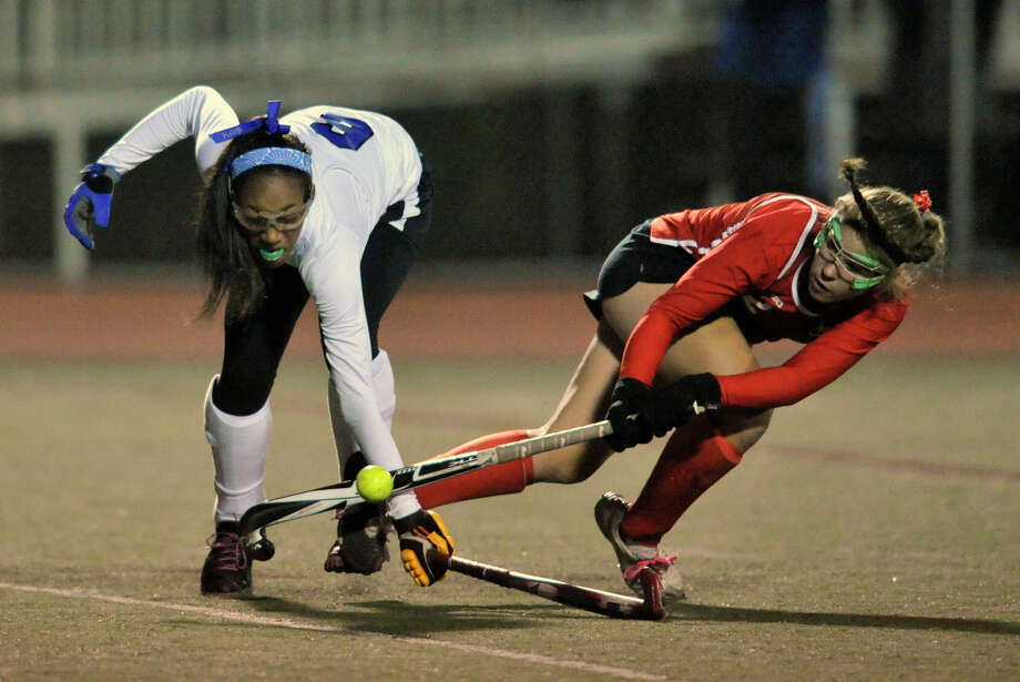 Darien's Kyla Johns attempts to block the shot of New Canaan's Catherine Granito during their FCIAC semifinal game at Brien McMahon High School in Norwalk, Conn., on Tuesday, Oct. 29, 2013. Photo: Jason Rearick / Stamford Advocate