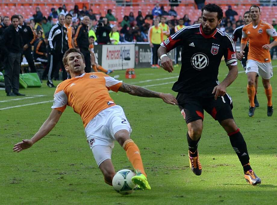 Eric Brunner, left, has been a reliable defender in his first season playing for the Dynamo, much to the dismay of opponents like Dwayne De Rosario. Photo: Chuck Myers / MCT