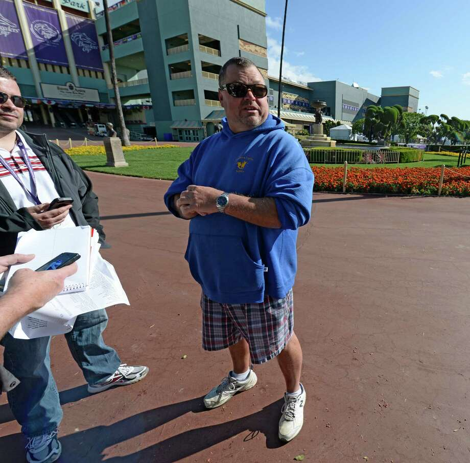 Eric Guillot, trainer of Travers Stakes runner-up and Breeders' Cup Classic entrant Moreno holds court with the media near the paddock at Santa Anita Race Track Oct. 29, 2013 in Arcadia, California.    (Skip Dickstein/Times Union Photo: SKIP DICKSTEIN
