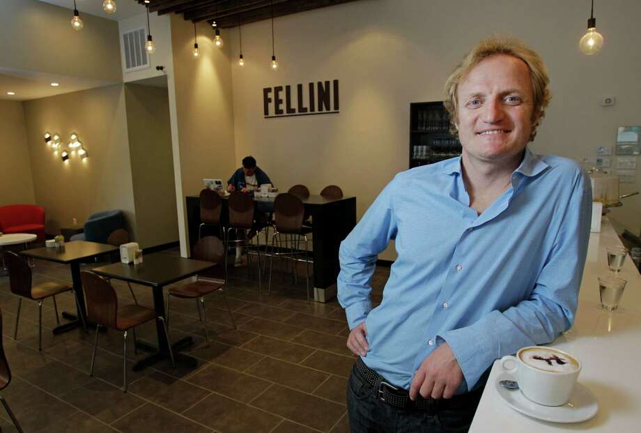 Co-owner Paolo Fronza has been able to quickly attract the city's Italian immigrants to Fellini Caffe. Photo: Melissa Phillip, Staff / © 2013  Houston Chronicle