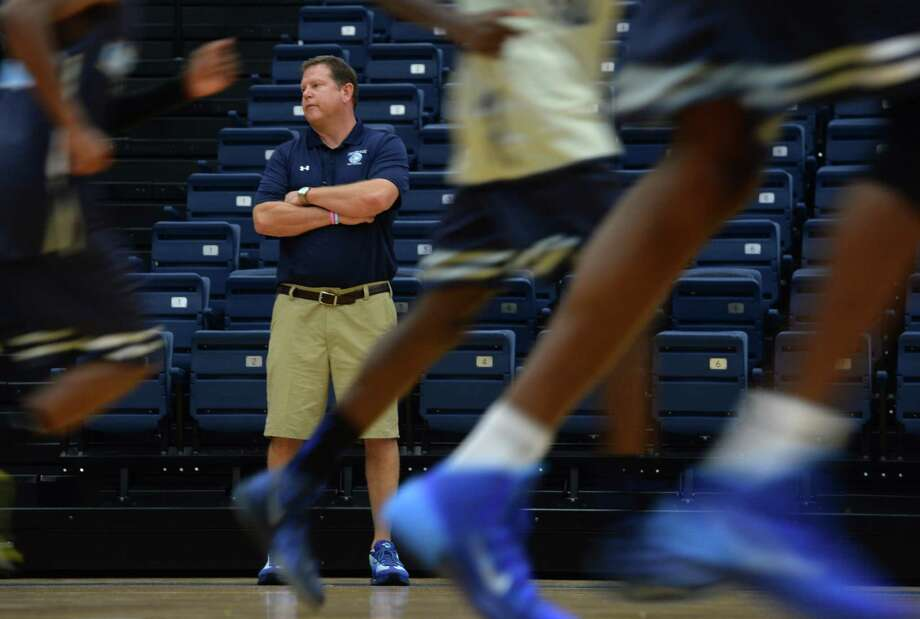 Lamar State College-Port Arthur head basketball coach Lance Madison watches his team practice at the team's gym. Madison is hoping his veteran team can build off of last year's 21-11 record.   Guiseppe Barranco/The Enterprise Photo: Guiseppe Barranco, Photo Editor