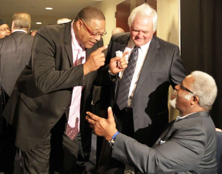 Robert Brazile, Wade Phillips and Earl Campbell at the memorial service for Bum Phillips. Photo: James Nielsen, Houston Chronicle