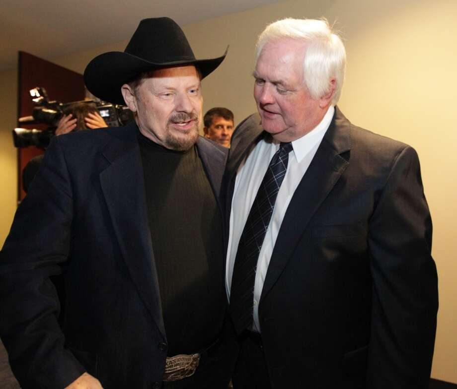 Moe Bandy and Wade Phillips at the Memorial Service for Bum Phillips. Photo: James Nielsen, Houston Chronicle