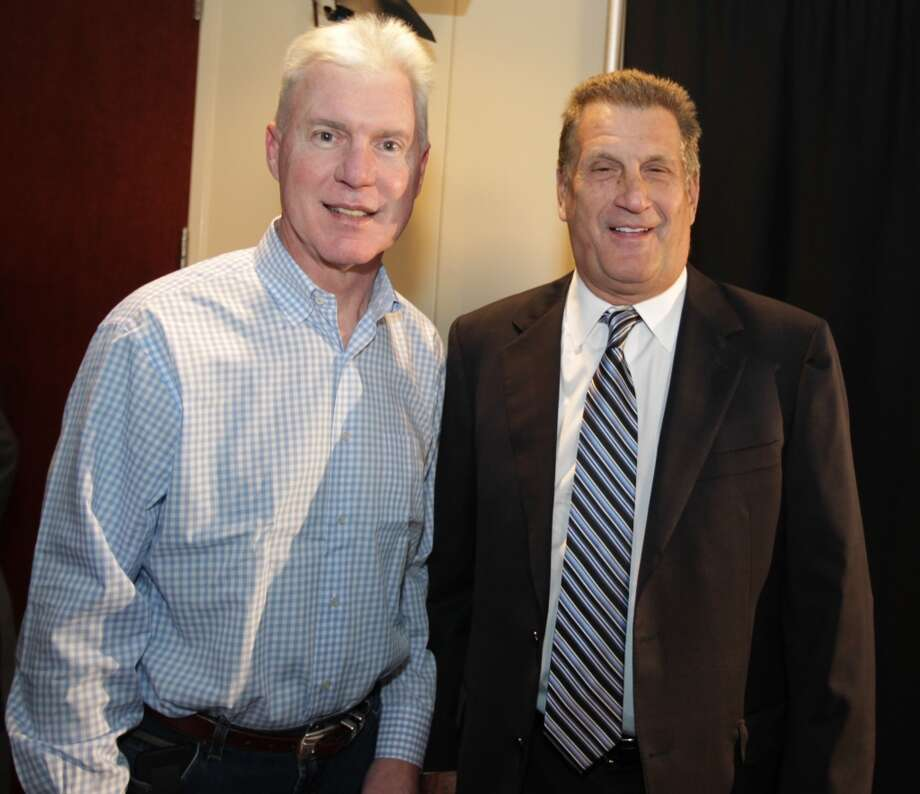 Ted Thompson and Mike Reinfeldt at the memorial service for Bum Phillips. Photo: James Nielsen, Houston Chronicle