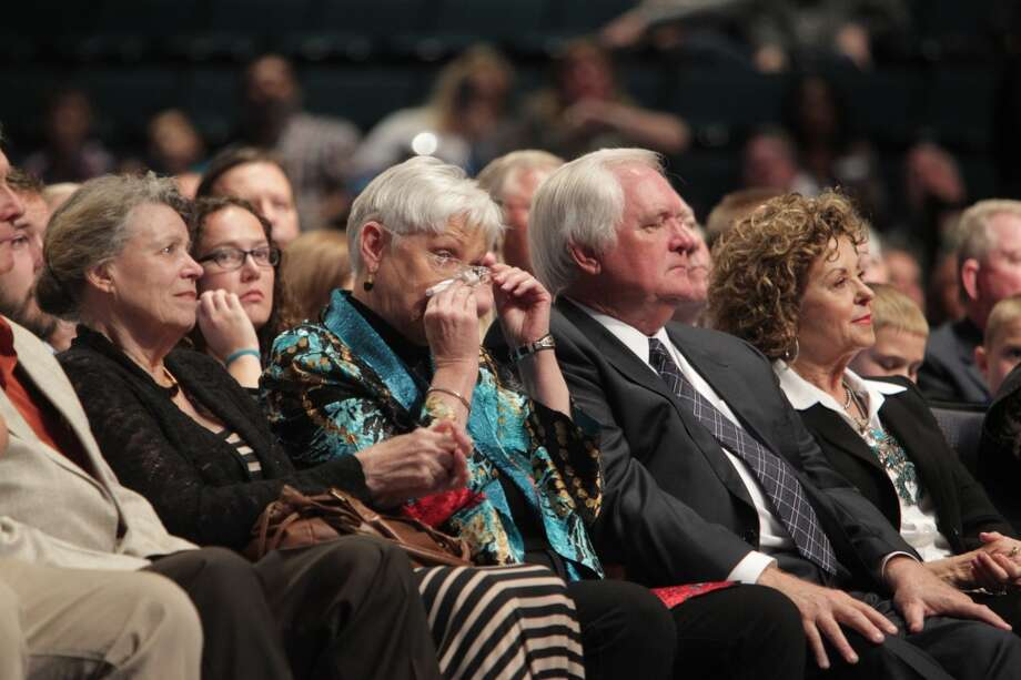 Debbie Phillips wipes away tears during the memorial for her husband Bum Phillips. Photo: James Nielsen, Houston Chronicle