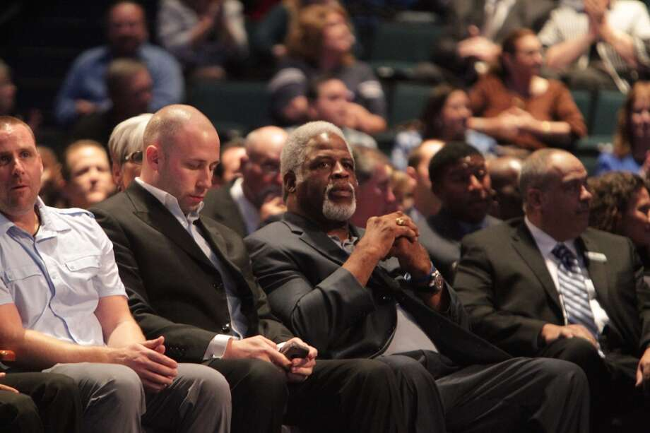 Oilers running back Earl Campbell watches the memorial service for Bum Phillips. Photo: James Nielsen, Houston Chronicle