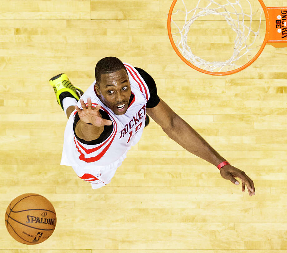 With Dwight Howard on board, the Rockets hope the superstar center takes the team to rarefied heights during an NBA season that starts tonight. Photo: Smiley N. Pool, Staff / © 2013  Houston Chronicle