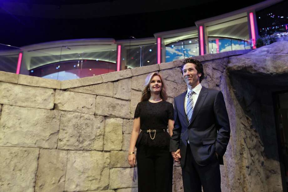 Joel and Victoria Osteen during the tribute for Bum Phillips. Photo: James Nielsen, Houston Chronicle