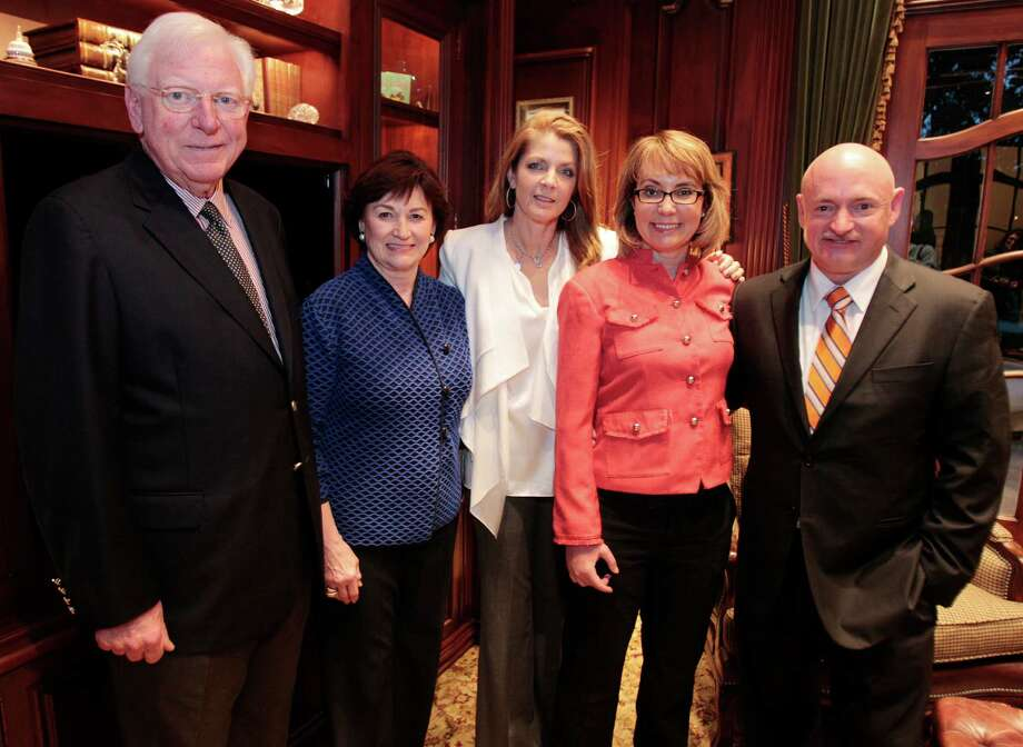 Former Texas Gov. Mark White, left, and his wife, Linda, joines Paige Fertitta, former U.S. Rep. Gabrielle Giffords, of Arizona, and her husband, former astronaut Mark Kelly, in Houston on Tuesday. Photo: Billy Smith II, Staff / © 2013 Houston Chronicle