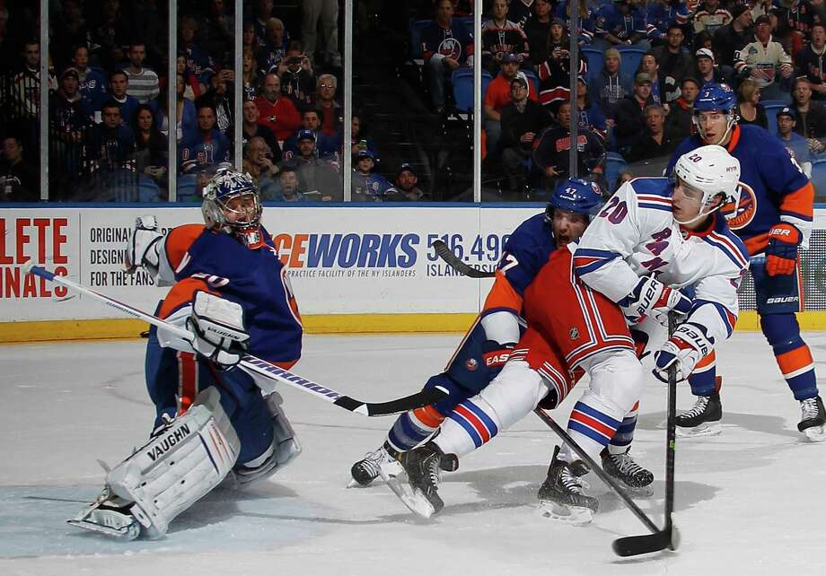 UNIONDALE, NY - OCTOBER 29: Chris Kreider #20 of the New York Rangers scores a powerplay goal against Evgeni Nabokov #20 of the New York Islanders at 12:30 of the first period at the  Nassau Veterans Memorial Coliseum on October 29, 2013 in Uniondale, New York.  (Photo by Bruce Bennett/Getty Images) ORG XMIT: 181109985 Photo: Bruce Bennett / 2013 Getty Images