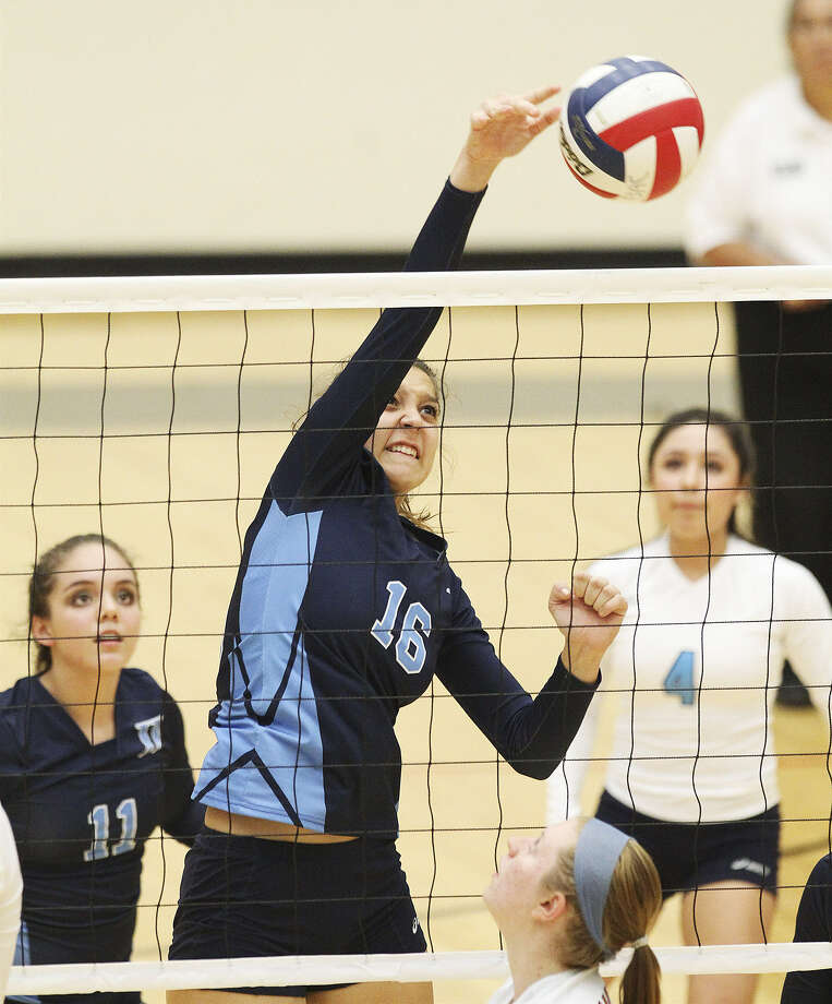 Johnson's Lauren Bault spikes the ball during a three-set victory over Madison at Littleton Gym. Johnson is the No. 3 seed from District 26-5A and will play New Braunfels in the first round of the playoffs, while Madison and MacArthur face a Friday showdown for the district's final spot. Photo: Kin Man Hui / San Antonio Express-News
