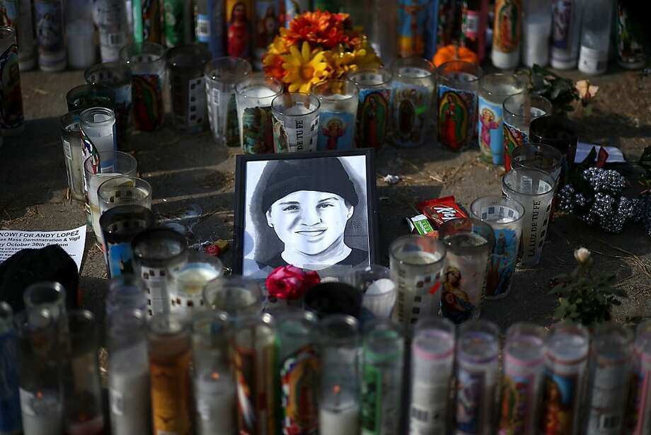 SANTA ROSA, CA - OCTOBER 29:  A picture of 13 year-old Andy Lopez sits with gifts and candles at a memorial on October 29, 2013 in Santa Rosa, California. 13 year-old Andy Lopez was shot and killed by a Sonoma County sheriff deputy as he carried a toy replica of an AK-47 assualt rifle one week ago.  (Photo by Justin Sullivan/Getty Images) Photo: Justin Sullivan, Getty Images