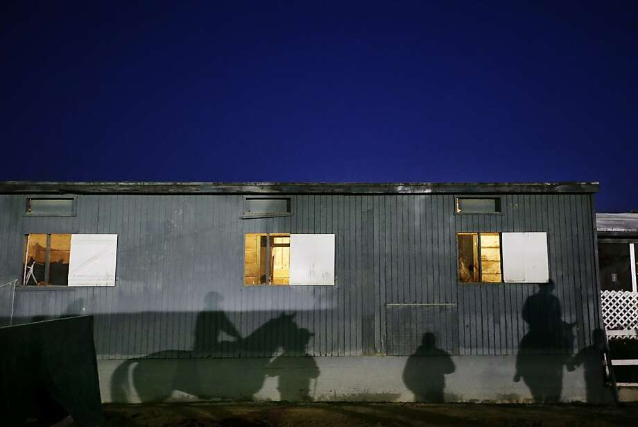 Horses and exercise riders cast their shadows as they get ready for a morning workout for this weeks Breeders' Cup horse races at Santa Anita Park on Tuesday, Oct. 29, 2013, in Arcadia, Calif. (AP Photo/Jae C. Hong) Photo: Jae C. Hong, Associated Press