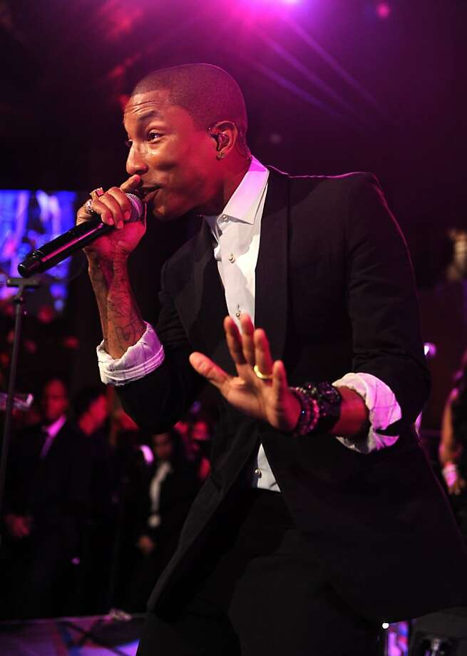 NEW YORK, NY - OCTOBER 29:  Pharrell Williams performs onstage during Gabrielle's Angel Foundation Hosts Angel Ball 2013 at Cipriani Wall Street on October 29, 2013 in New York City.  (Photo by Jamie McCarthy/Getty Images for Gabrielle's Angel Foundation) Photo: Jamie McCarthy, (Credit Too Long, See Caption)