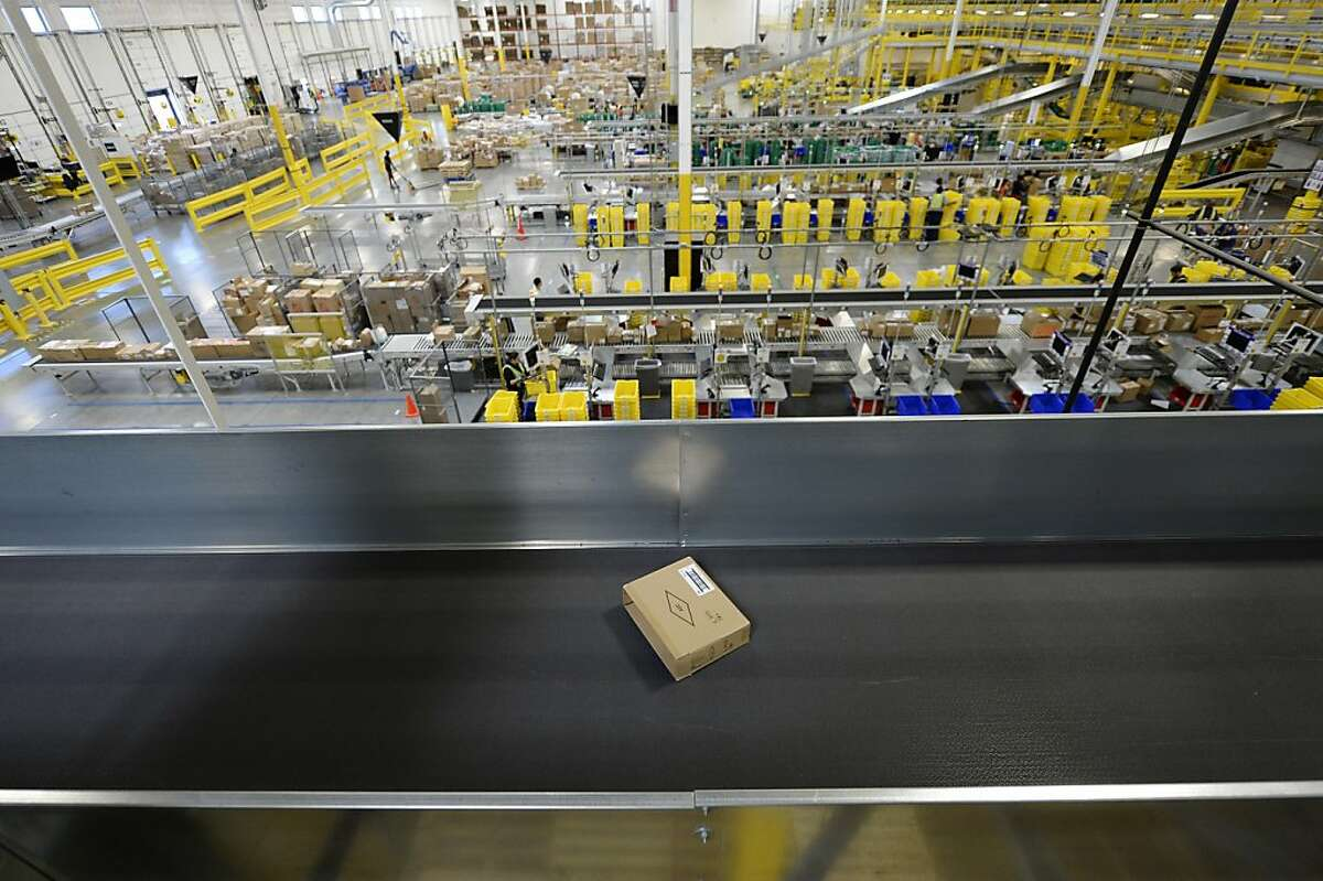 SAN BERNARDINO, OCTOBER 29: A box travels down a conveyor at Amazon's San Bernardino Fulfillment Center October 29, 2013 in San Bernardino, California. Amazon's 1 million-square-foot facility in the economically hard-hit San Bernardino County has created more than 800 jobs at the center. Fulfillment centers are where products sold by other vendors on Amazon.com store their inventory. (Photo by Kevork Djansezian/Getty Images)
