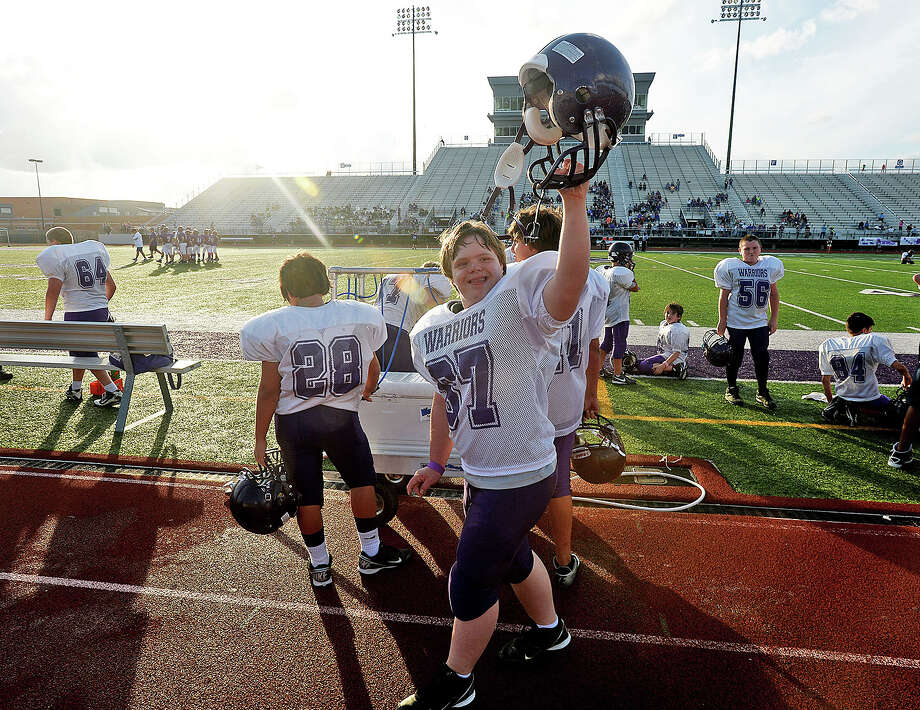 Port Neches middle school football players, Robert Peltier, 64, and Carson Pitrie, 67, played their first game of the season despite disabilities, Tuesday at Port Neches Groves high school. Michael Rivera/The Enterprise