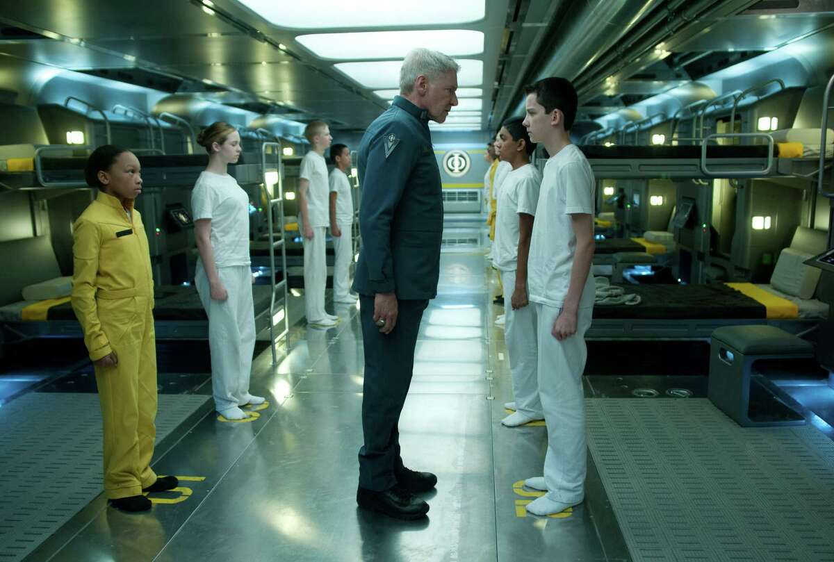 HARRISON FORD (center) and ASA BUTTERFIELD (right) star in ENDER'S GAME Photo: Richard Foreman Jr., SMPSP 2012 Summit Entertainment, LLC. All Rights Reserved.