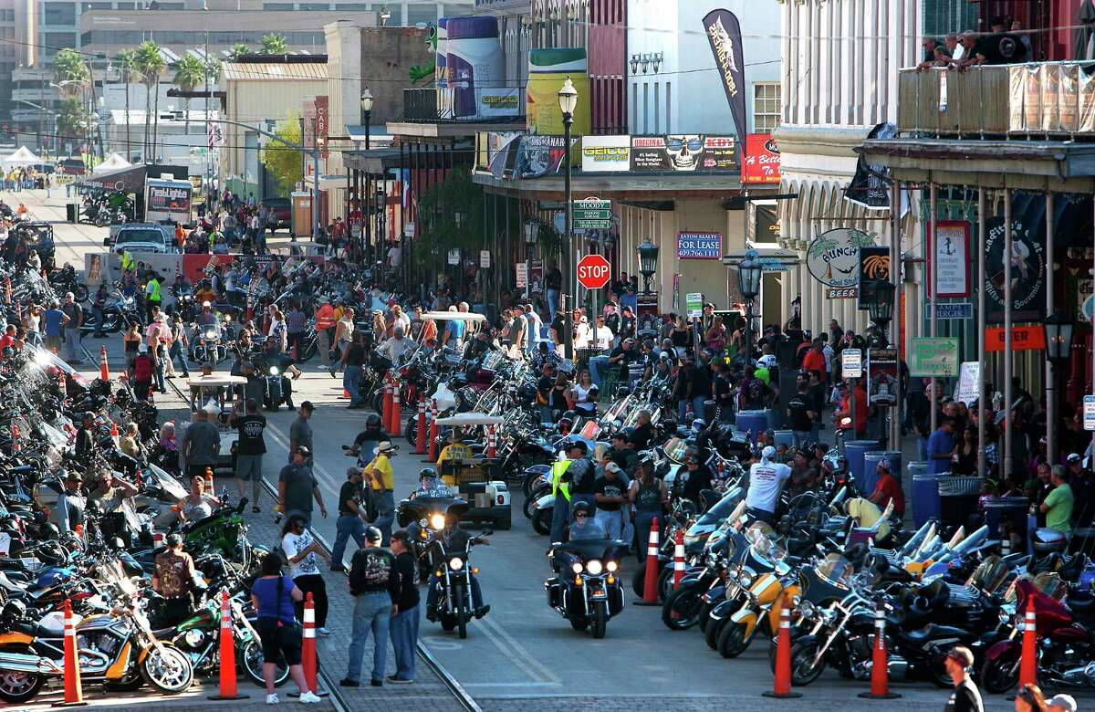 """Bikers ride as they look for a place to park during the Lone Star Rally Saturday, Nov. 3, 2012, in Galveston. The Rally featured different events including a free concert by Bret Michaels, different bike shows and some of the world's top bike builders along with a guest appearance from Charlie """"Jax"""" Hunnam from the hit show, """"Sons of Anarchy."""" (Cody Duty / Houston Chronicle)"""