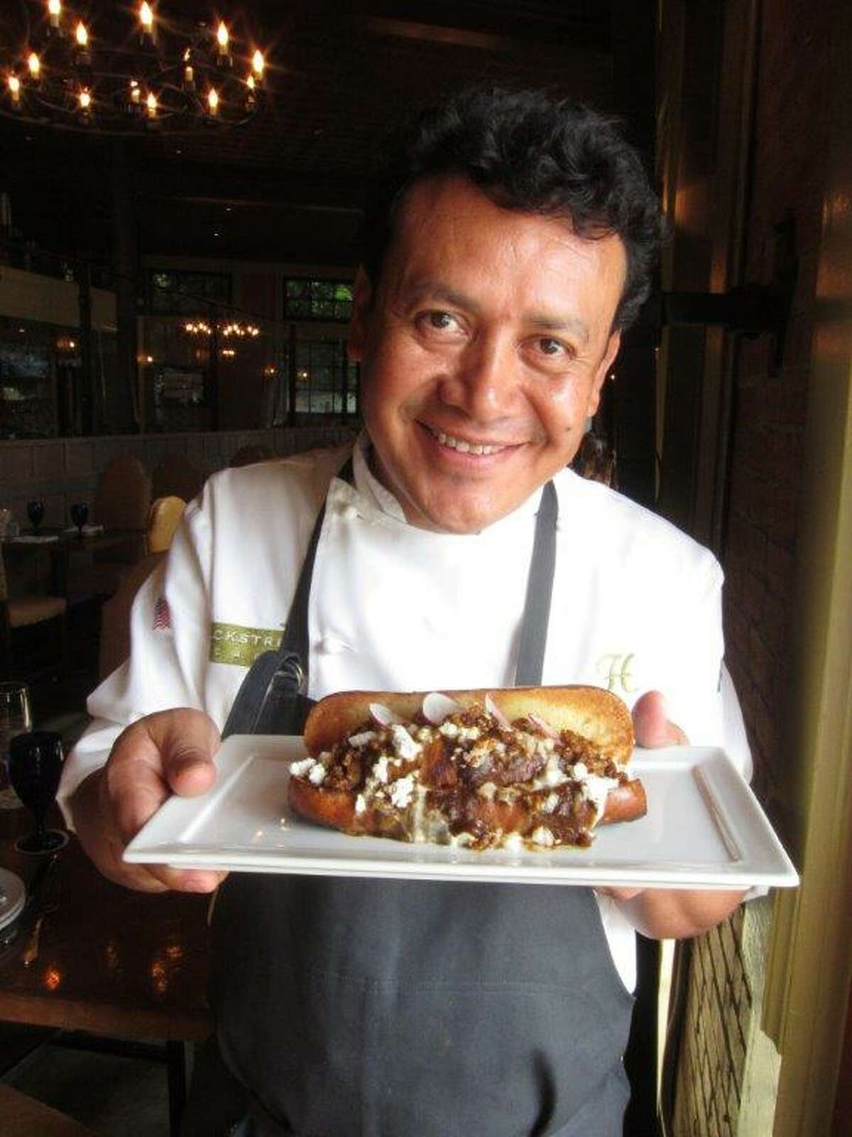 Hugo Ortega, the executive chef/co-owner of the popular Hugo s, Backstreet Caf , Prego and the soon to open Caracol, will be introducing his Holy Mol dog at all 21 James Coney Island stores the day after Halloween. Chef Ortega, who is the sixth participating chef in the series, has created a saucy/cheesy dog using a smoked chicken Andouille sausage on a Slow Dough pretzel bun, topping it with tinga, mol sauce, queso fresco, crema fresca and minced onions. It s garnished with sliced radish. It's called the Holy Mol