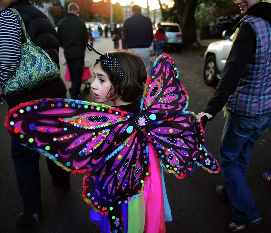 Rainbow butterfly Maggie Lupa, 6, of Bridgeport, floats along Tuesday, Oct. 29, 2013 during the 5th Annual Black Rock Halloween Parade & Block Party beginning at Ellsworth Park and ending at the Black Rock Branch Library. The Black Rock neighborhood ZIP code, 06605, came in 12th on a list of top trick-or-treating territories in all of Southwestern Connecticut. Bridgeport's 06606 came in second place to Stamford's 06902. Photo: Autumn Driscoll / Connecticut Post