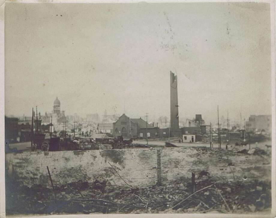 Image showing some of the destruction from the 1906 San Francisco Earthquake and fire. The exact location is unknown. But, you can see the ruins of City Hall in the distance.