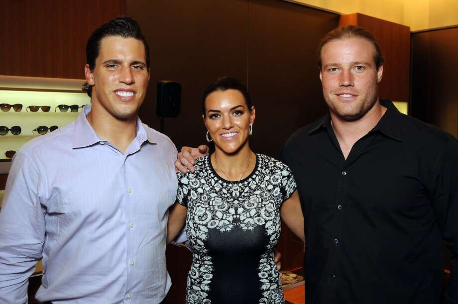 Host Brian Cushing with his wife Megan and teammate Brooks Reed at a VIP preview event for David Yurman's Meteorite Collection Tuesday Oct. 29,2013.  (Dave Rossman photo) Photo: Dave Rossman, For The Houston Chronicle