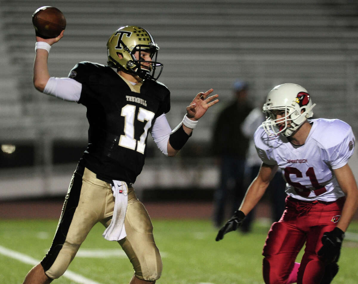 Trumbull QB Nick Roberts passes the ball, during football action against Greenwich in Trumbull, Conn. on Friday October 18, 2013.