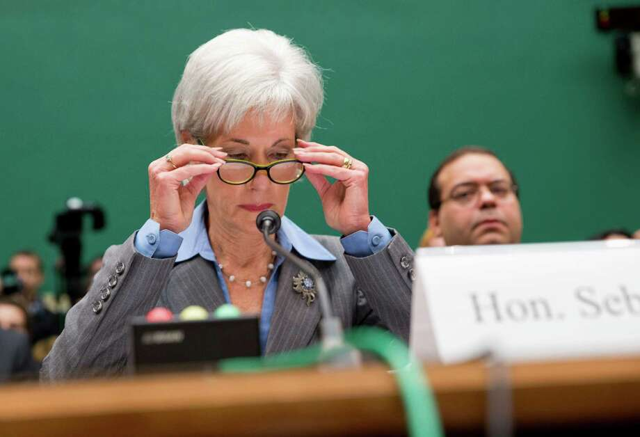 Health and Human Services Secretary Kathleen Sebelius prepares to testify on Capitol Hill in Washington, Wednesday, Oct. 30, 2013,  before the House Energy and Commerce Committee hearing on the difficulties plaguing the implementation of the Affordable Care Act. President Barack Obama's top health official faced tough questioning by a congressional committee Wednesday that will demand she explain how the administration stumbled so badly in its crippled online launch of the president's health care overhaul. Photo: J. Scott Applewhite, AP / AP