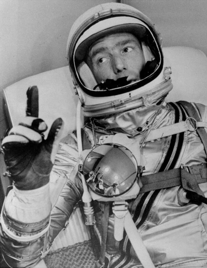 Astronaut Scott Carpenter gestures with one hand after donning his space suit in Hangar S prior to being shot into orbit in 1962 at Cape Canaveral, Fla. Photo: NASA / Associated Press