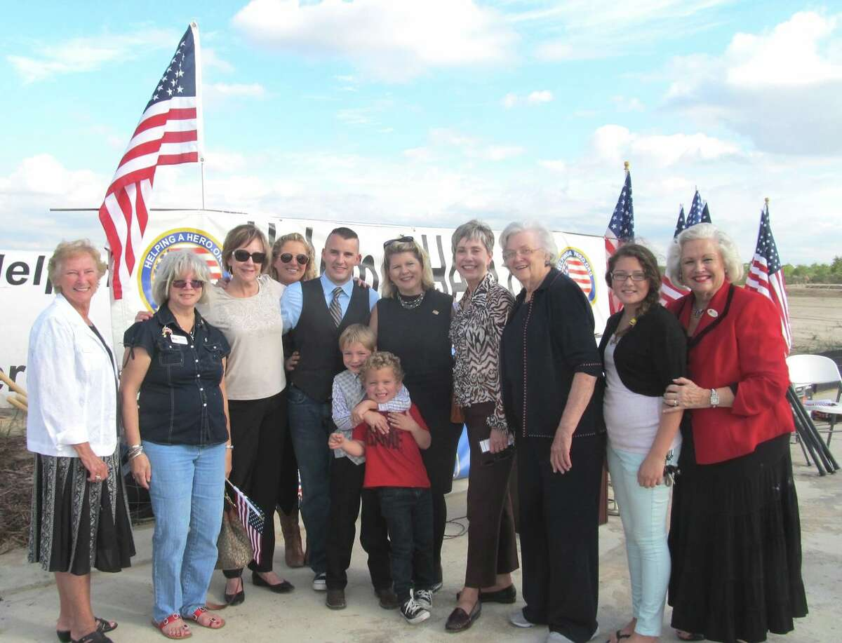 Members of the Heritage Trails and Tejas DAR chapters at groundbreaking ceremonies with Brandon Byers, his family and Meredith Iler, national chairwoman and founder of HelpingaHero.org Home program.