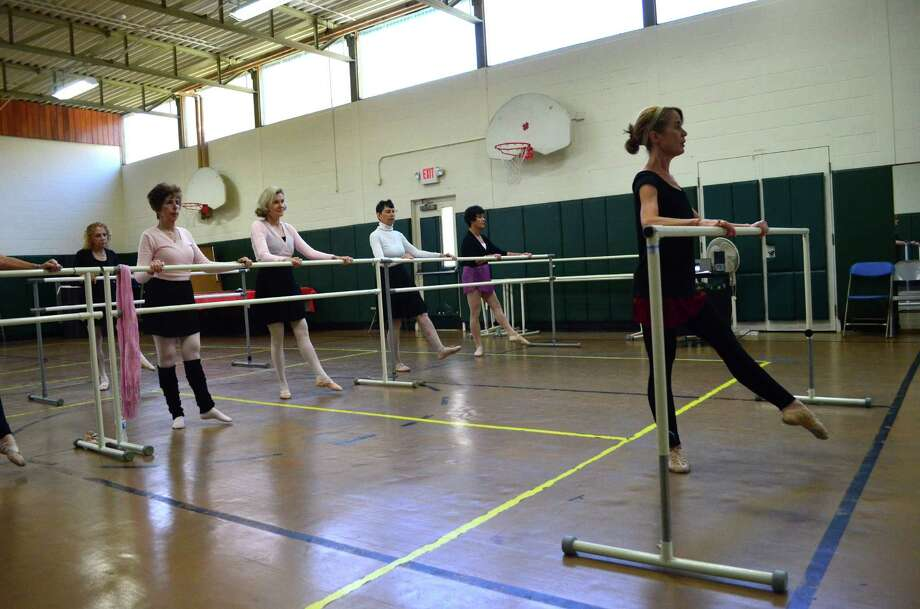 Elizabeth Hall, front, teaches a ballet class at the Darien Senior Center. Andrea Levine, from left, Suzanne Wilsey, Claire DeLuth and Pat Podkowsky mimic Hall. Photo: Megan Spicer / Darien News