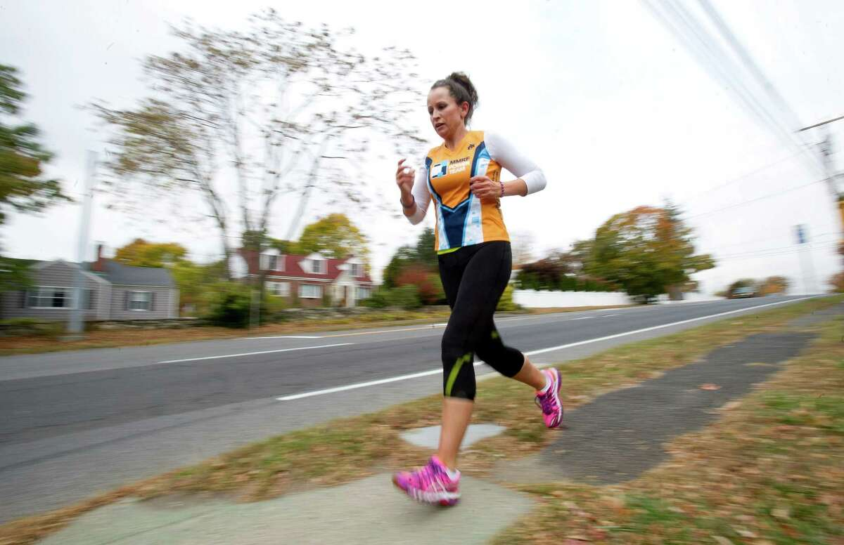 Lushe Gjuraj trains for the New York City marathon along High Ridge Road in Stamford, Conn., on Wednesday, October 30, 2013. The marathon will be held November 3, 2013, and Gjuraj is running to raise money for the Multiple Myeloma Research Foundation.