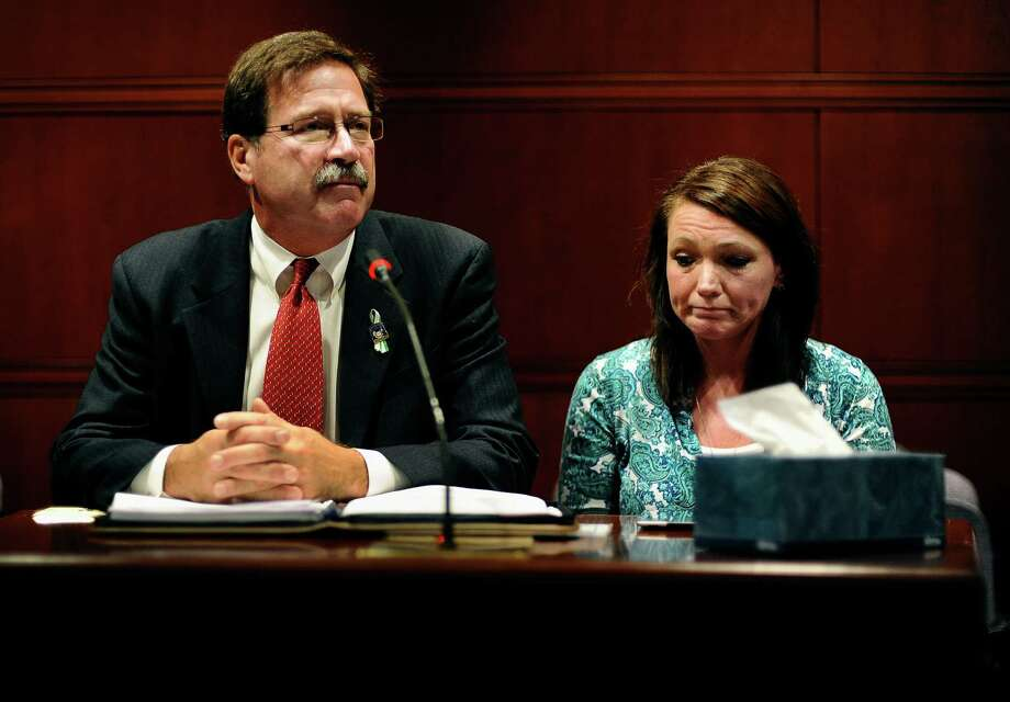 Bill Sherlach, husband of Sandy Hook Elementary School shooting victim Mary Sherlach, left, and Nicole Hockley, mother of victim Dylan Hockley, speak before the Task Force on Victim Privacy and the Publics Right To Know, Wednesday, Oct. 30, 2013, in Hartford, Conn. Sherlach and Hockley told the panel they don't want the 911 tapes from that day released to the public. The Freedom of Information Commission has ordered the release of the 911 recordings, but a prosecutor has said the ruling will be appealed. Photo: Jessica Hill, AP Photo/Jessica Hill / Associated Press