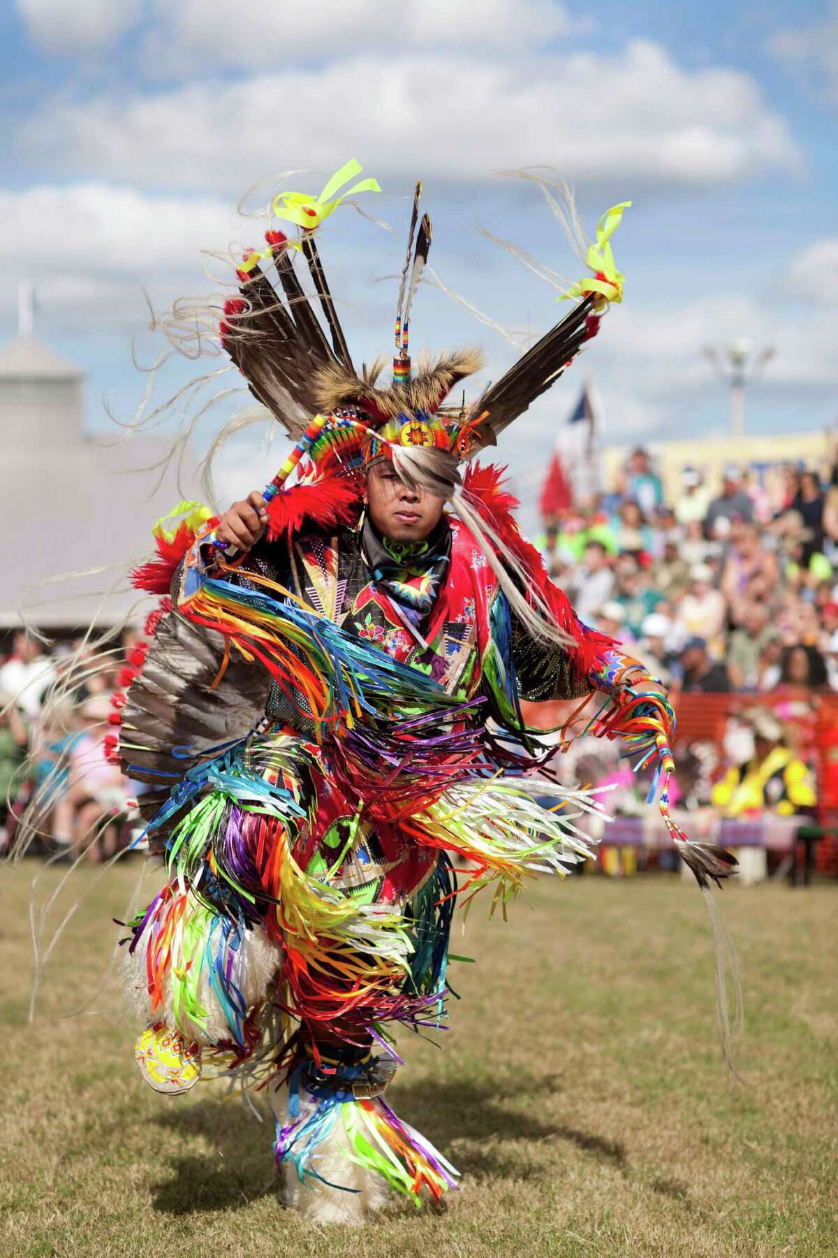 A dancer performs at a past Pow Wow.