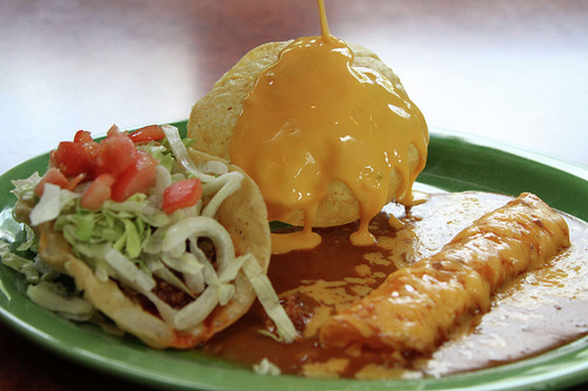 Crispy beef taco, puffy queso and cheese enchilada.
