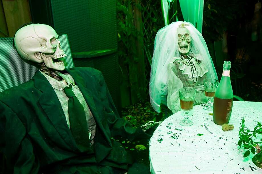Maybe we should have gone with a shorter ceremony:The bride and groom enjoy a beverage at a Halloween wedding reception in the 