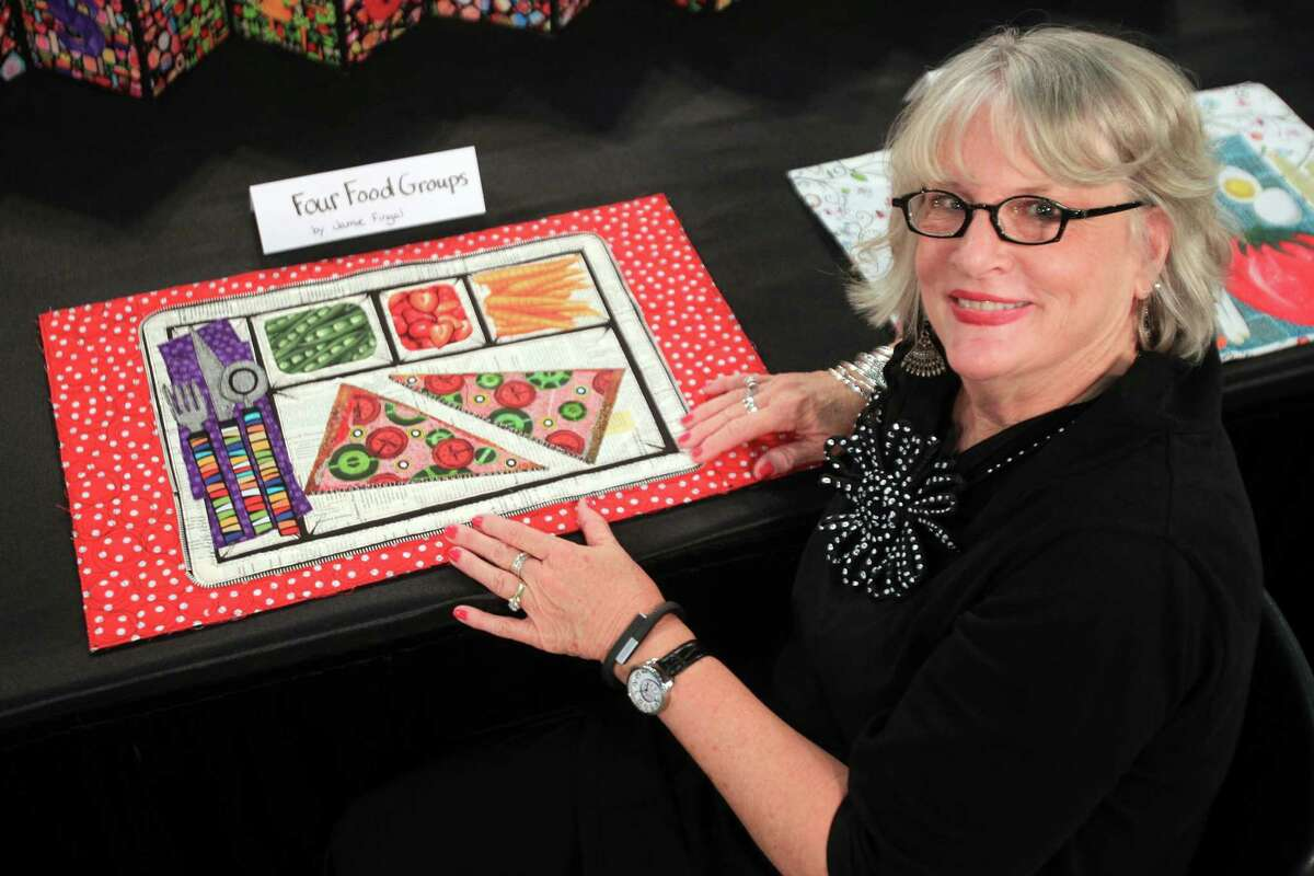 """""""What's for Dinner?"""" exhibit coordinator Leslie Tucker Jenison is proud of her """"Nourishment and Tradition"""" quilt."""