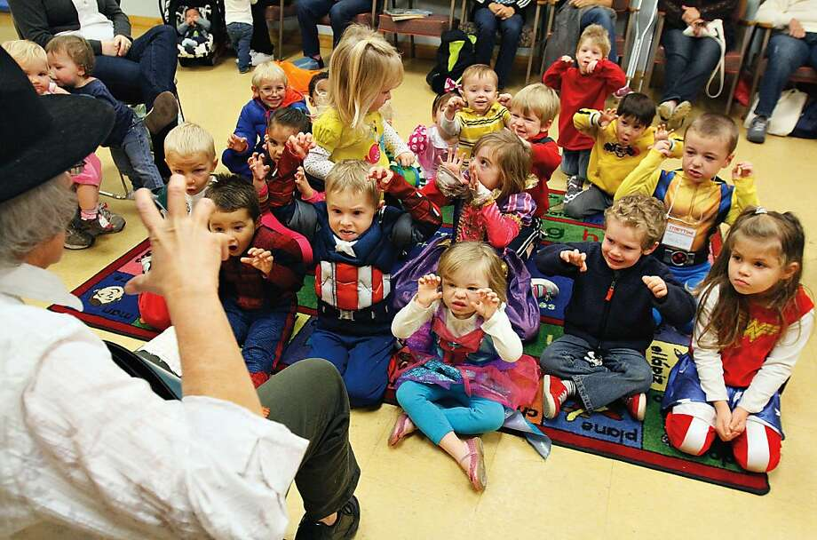 Now, children, what do we think of people who return overdue books? Preschoolers make scary faces as Carol 