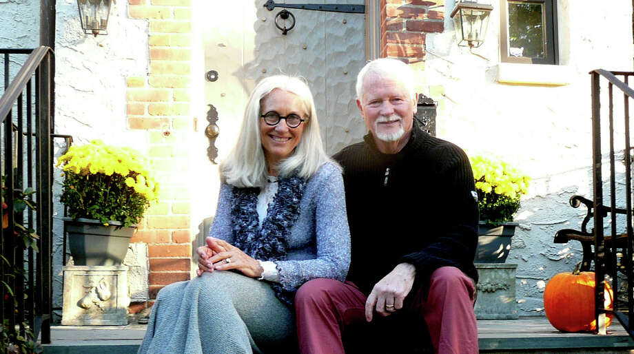 On the doorstep of their Dearfield Lane home, Ken McAdams and his wife, Marian ìîBingî Bingham, rest during a heavy week of readying their home for a brokerís Open House. ìTo really sell a place you just have to go all out ñ itís a 100 percent teamwork effort,î said McAdams. Photo: Anne W. Semmes / Greenwich Citizen
