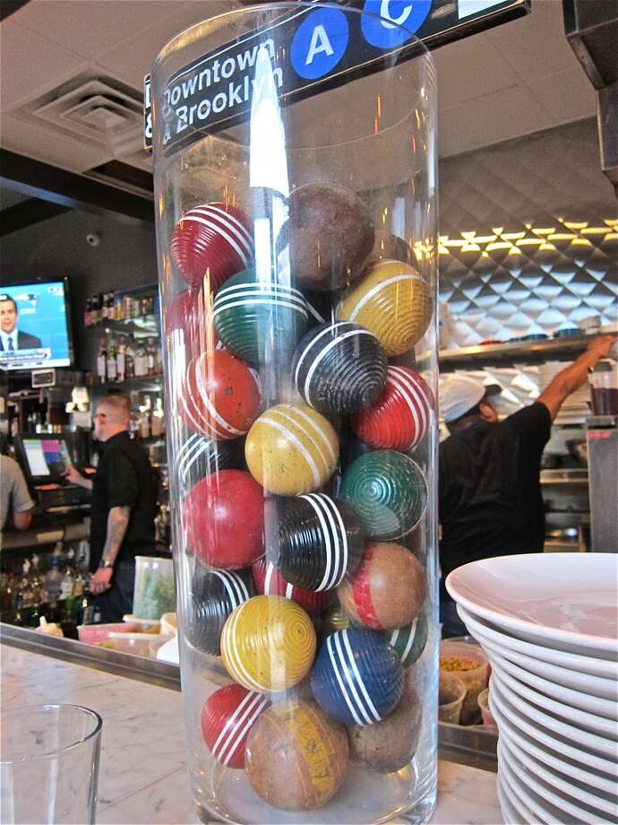 Croquet balls are part of the decor at the Brooklyn Athletic Club's bar. Photo: Alison Cook
