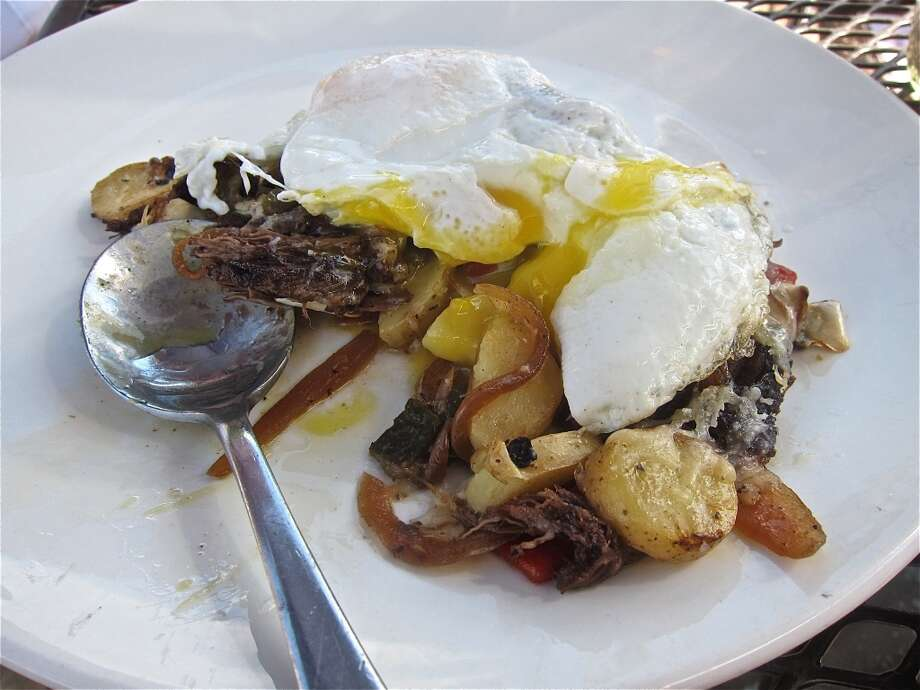 Shortrib and fingerling hash with a fried egg, a brunch special at Brooklyn Athletic Club. Photo: Alison Cook