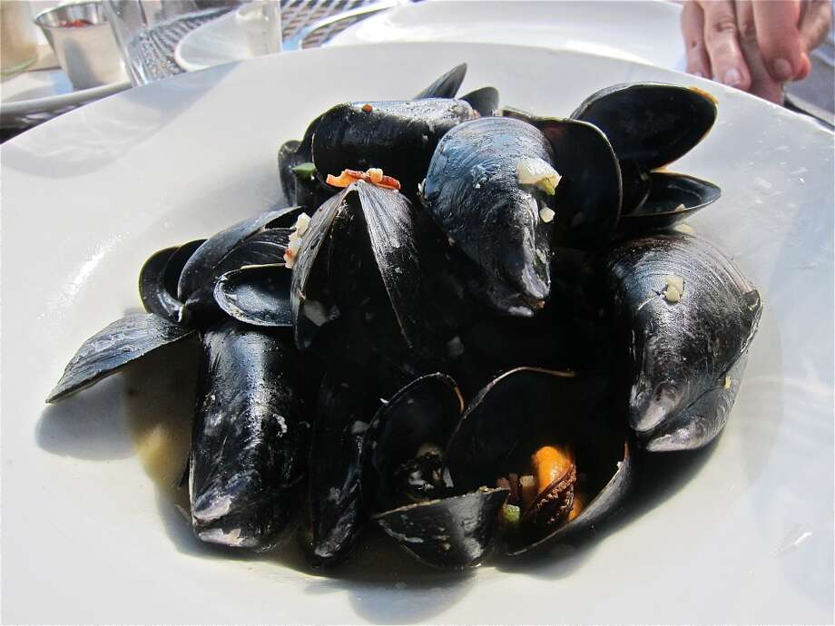PEI mussels with beer, bacon, and jalapeño at Brooklyn Athletic Club. Photo: Alison Cook