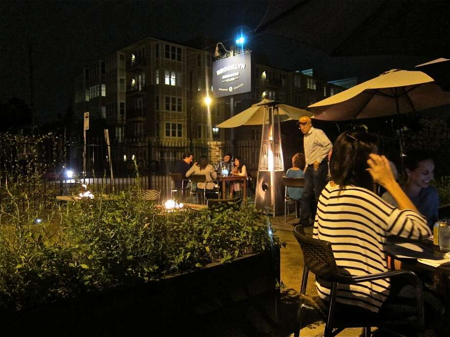 Night crowd around the fire pits at Brooklyn Athletic Club. Photo: Alison Cook